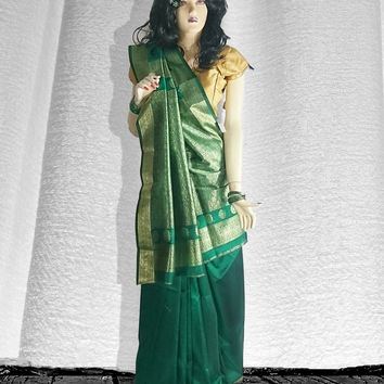 the woven silk saree in luminous green and gold embellishment zari