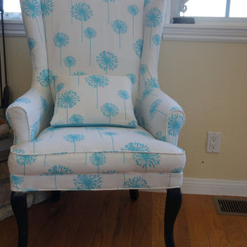 Reupholstered vintage wing back chair and refinished wood legs, stained black.