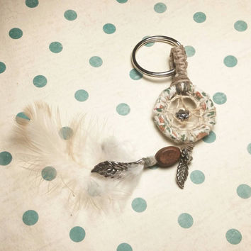 Handmade Dreamcatcher Keychain with feathers and beads.