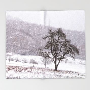 Old pear tree on a wintery meadow Throw Blanket by Pirmin Nohr