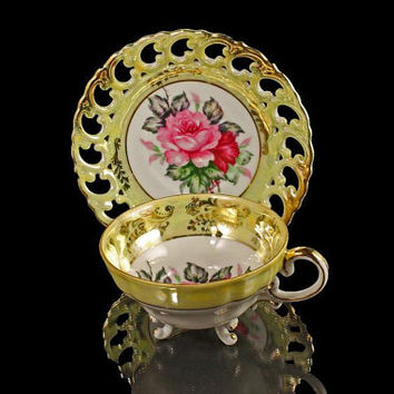 Three Footed Teacup With Reticulated Saucer