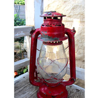 Vintage lantern. Oil lamp. Red lantern. Metal lantern. Oil lantern. Railroad lantern. Shabby chic lantern. Old distressed barn lantern.