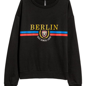 H&M Sweatshirt with Printed Design $9.99