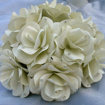Two custom, made to order paper flower table settings. Wedding table centerpieces, wedding cake toppers