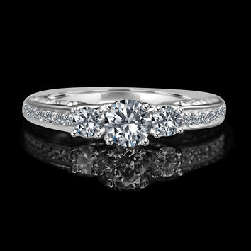 Round three stones diamond simulant - diamond veneer® ring set in sterling silver.635r204