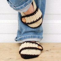 Neutral browns crocheted slippers, booties, shoes, socks with a button strap.