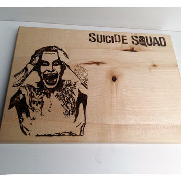 "Wooden cutting board with handmade ""Suicide Squad"" pyrography design."