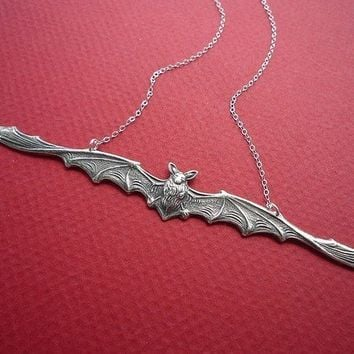 skinny bat necklace in silver
