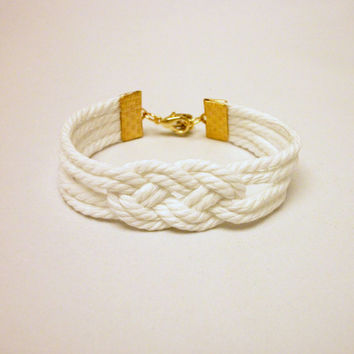 Matte white double infinity knot nautical rope bracelet with gold anchor charm