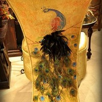 Peacock chair. Real peacock feathers used in design on the outback