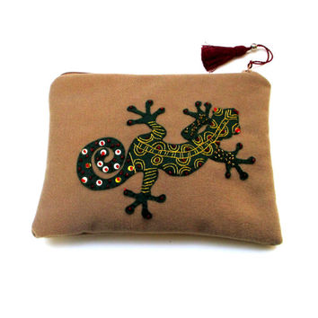 Beige lampswool  pouch, handmade, hand  embroidered  with a gecko ,clutch