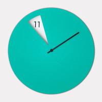sabrina fossi's minimally designed freakish wall clock - designboom | architecture & design magazine
