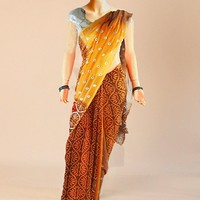 The caramel blend georgette saree with print and silver sequins