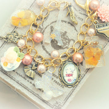 Paris theme bracelet, charms including Marie Antoinette altered art picture, Eiffel Tower, dried orange viola resin charms, gift under 20