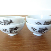 Four small porcelain Asian sauce bowls