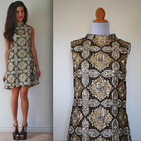 Vintage 60s Black and Gold Medallion Metallic Shift Dress (size medium)
