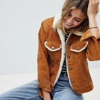 ASOS DESIGN cord jacket with fleece collar in rust brown at asos.com