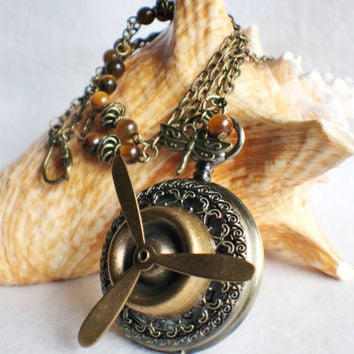 Propeller watch pendant, pocket watch with bronze propeller mounted on front case.