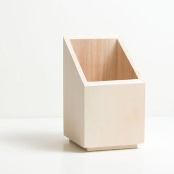 Wooden pencil holder in elegant modern design.