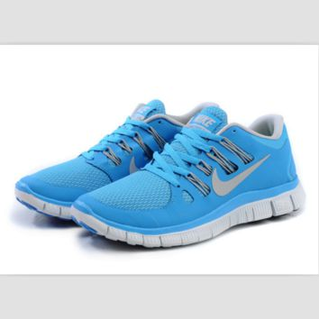 NIKE running breathable casual shock Damping running shoes Blue and white