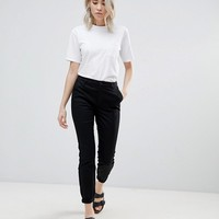 ASOS DESIGN skinny chino pants with roll up at asos.com