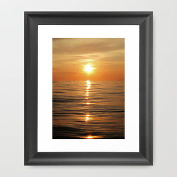Sun setting over calm waters Framed Art Print by Nicklas Gustafsson