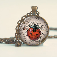 Pendant with Chain - Lady bug walking on a map