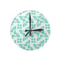 Mint Green And White Graphic Art Pattern Wall Clocks from Zazzle.com