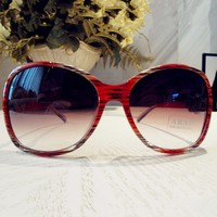 Oversize Sunglasses with Flower and Rhinestone on the Legs Orange GFH