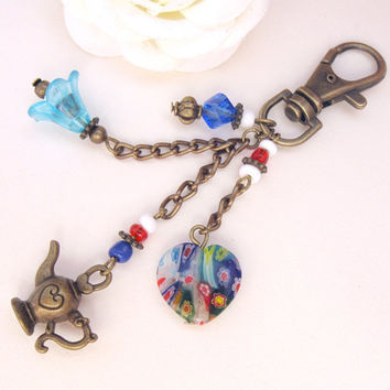Bronze keychain with millefiori glass heart, Alladin lamp and blue flower