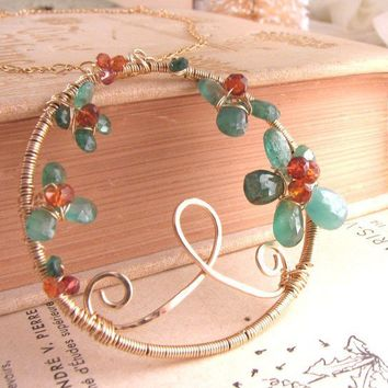 Emerald wire wrapped gold gemstone necklace by shadowjewels