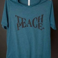 "Gina ""Teach Peace"" Teal Tee"