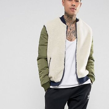 ASOS Borg Bomber Jacket With Nylon Sleeves In Beige at asos.com