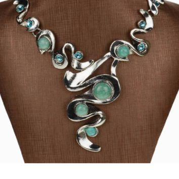 Dramatic Turquoise Bib necklace in Tibetan silver