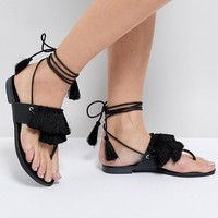 Truffle Collection Fringe Tie Up Flat Sandal at asos.com