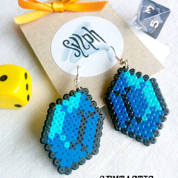 Blue with a turquoise shine geeky 8bit retro Zelda game inspired Gemtastic earrings in an emeral shape made of Hama Mini Perler Beads