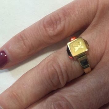 Authentic gold tone Louis Vuitton ring with stones sz M