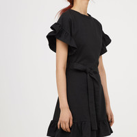 Flounced jersey dress - Black - Ladies | H&M GB