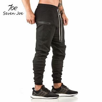 New sweatpants Men's solid workout bodybuilding clothing casual zipper pocket sweatpants joggers pants skinny trousers