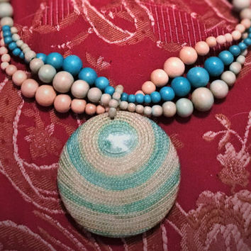Isadora Wood Bead Necklace Witn Large Enamel Round Pendant Pastel Blues, Biege  and Pink