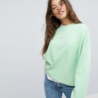 Calvin Klein Jeans Sweatshirt with Tonal Logo at asos.com