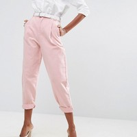 ASOS Tapered Jeans with Curved Seams and Belt in Pink at asos.com
