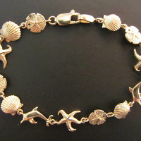 "14k Solid Gold Sea Life - Shell, Sand Dollar, Starfish & Dolphin Bracelet - 7 3/8""x 9mm - 6.41g"