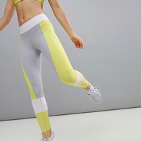 Asics Training Colourblock Legging In Grey And Lime at asos.com