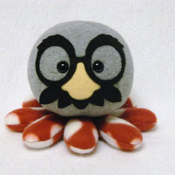 Stuffed octopus plush toy with silly glasses