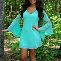 dress in mint with v-neck and bell sleeves