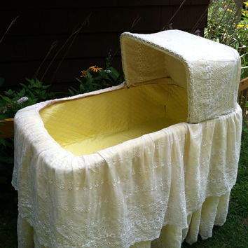 Vintage wicker bassinet, yellow double eyelet lace cover, rolling stand, vinyl lining, functional home decor baby room nursery shower gift