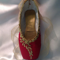 Red and gold Diana and Actaeon themed pointe shoe with tiny bow. Decorative pointe shoe.