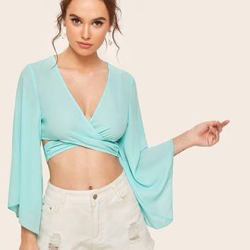 b155585e38a1f7 Plunging Neck Bell Sleeve Cross Wrap Crop Top