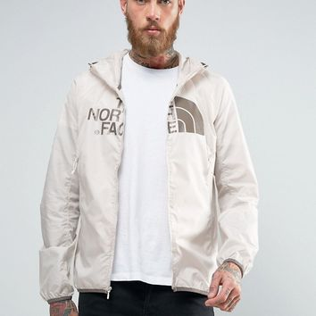 The North Face Logo Hooded Jacket Drew Peak Windwall in Off White at asos.com